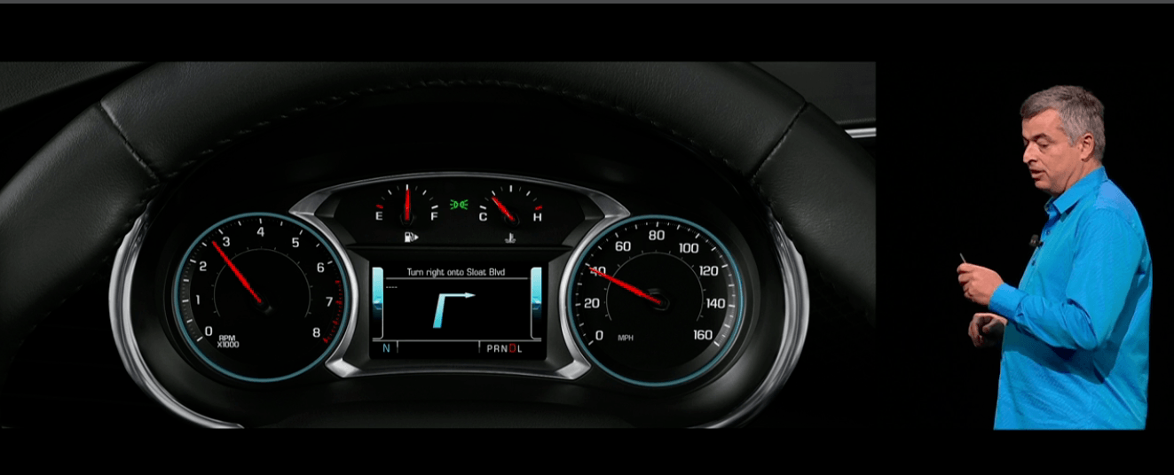 Eddy Cue introducing turn-by-turn direction integration with center instrument clusters.